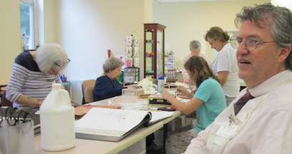 Residents decorating cigar boxes with wallpaper