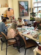 Residents making jewelry