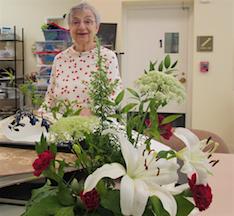 resident behind flower arrangement