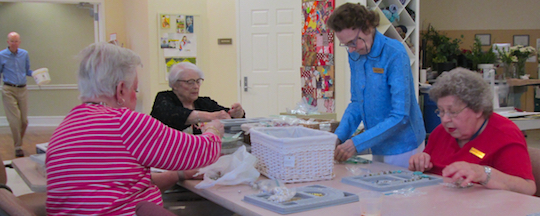 Residents creating jewelry