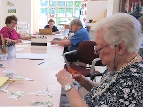 Residents working in the Art Center