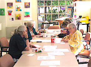 residents writing postcards