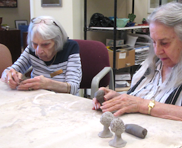 residents working on clay trees