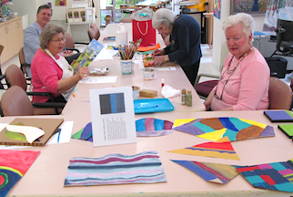 Residents working on various projects in the Art Center