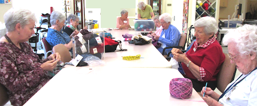 Residents knitting children's sweaters for charity