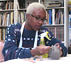 ceramist instructing how to attach a handle