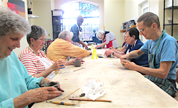 residents making clay pots or dishes