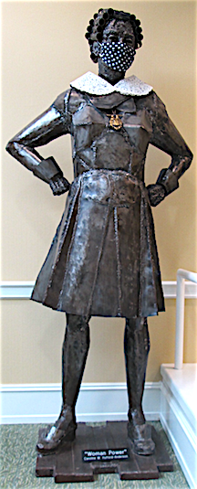 statue of Woman Power - metal with COVID mask and RGB collar